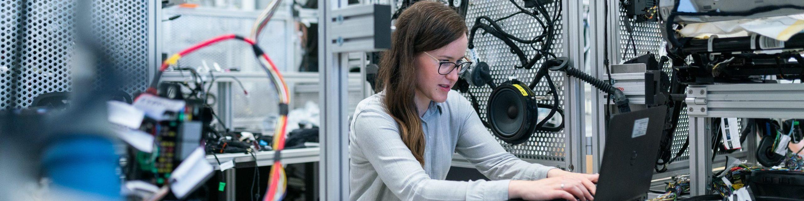 Female engineer works on computer